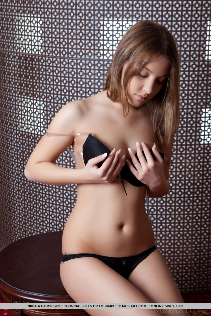 Nikia A strips her black lingerie as she flaunts her sexy, nubile body.