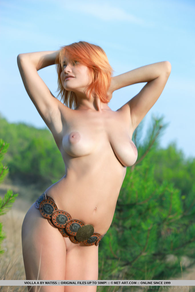 Redhead Violla A bares her sexy, naked body and big tits outdoors.