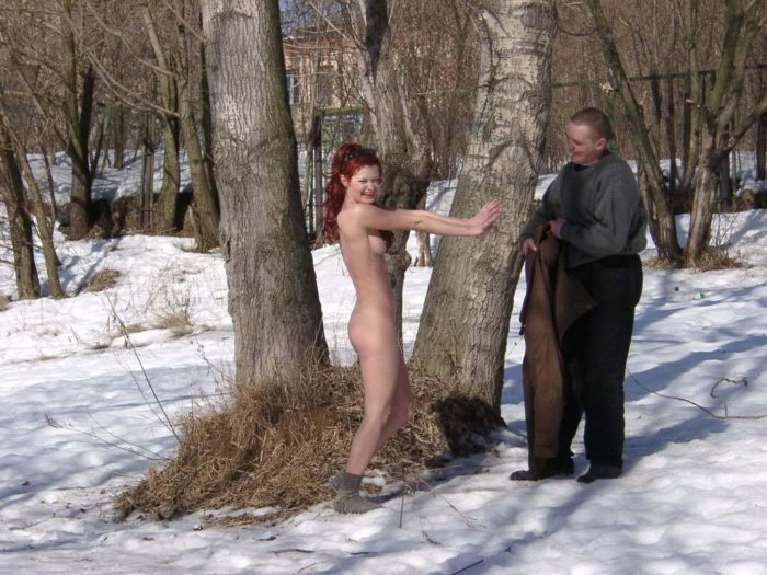 Redheaded girl Sabiria with a stranger at winter park