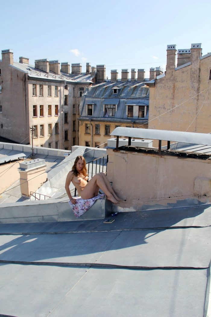 Russian teen with soft boobs smokes on the roof