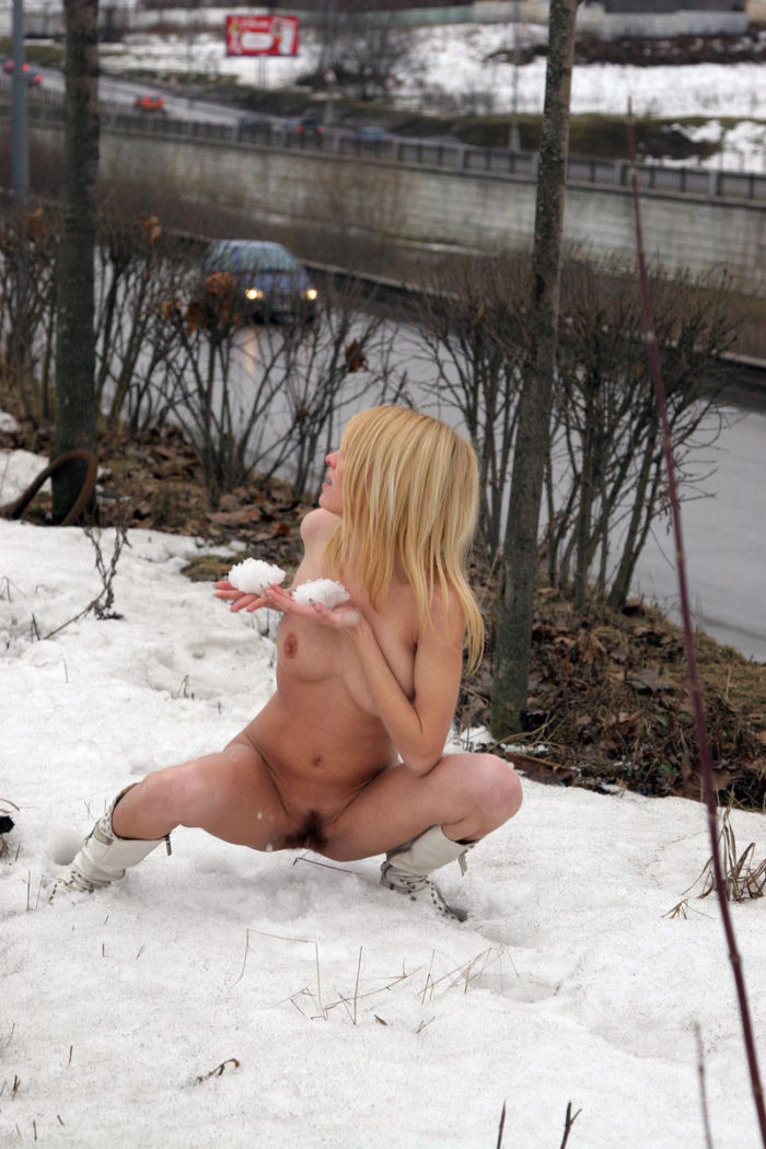 Shameless blonde with hairy pussy posing near busy road