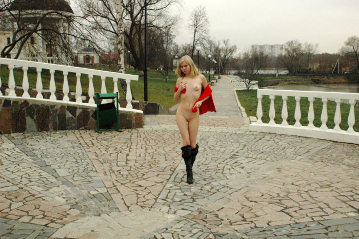 Skinny blonde Julia G in black boots and red scarf