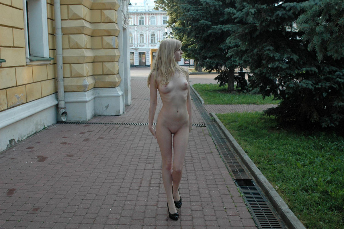 Skinny blonde exhibitionist Julia G at the streets ...