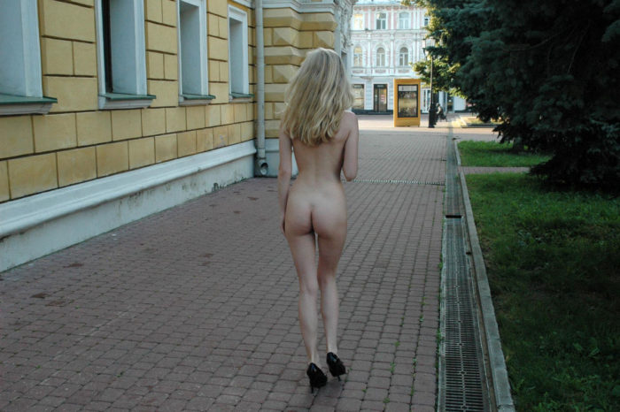 Skinny blonde exhibitionist Julia G at the streets