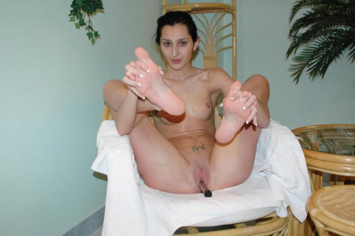 Skinny young brunette masturbates in sauna