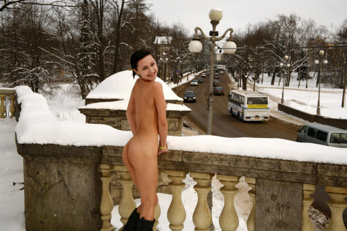 Slim girl Oksana O near the busy road