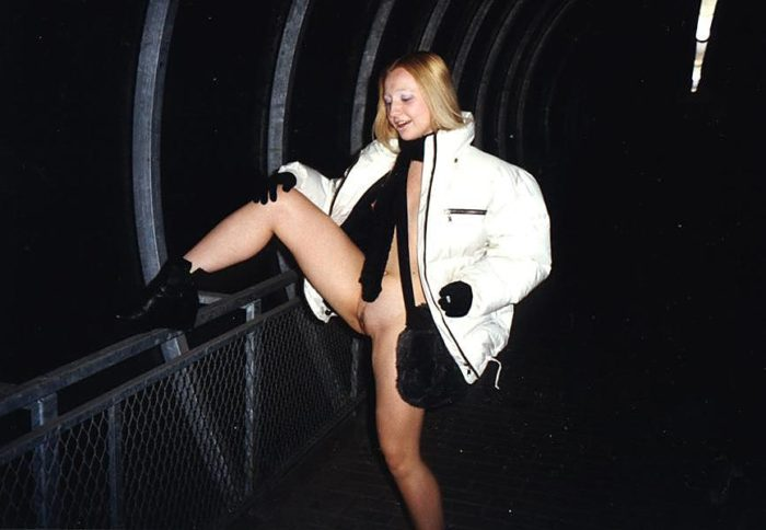 Small-tittied blonde Elza posing naked in overhead passage