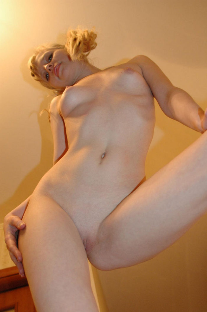 Sweet blonde sucks her leg fingers and shows pussy
