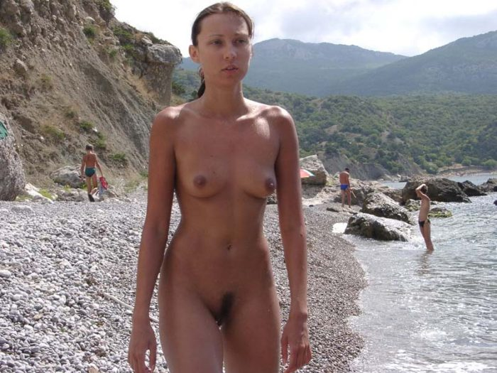 Teen Ulia with sporty body at public not-nude beach