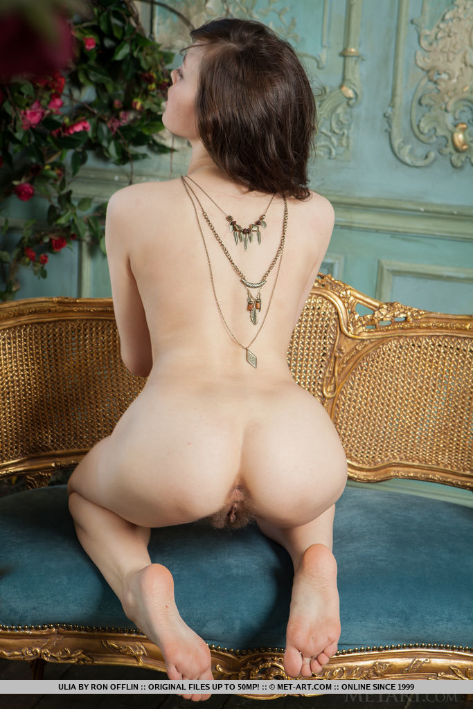 Ulia sensually poses in the balcony as she bares her unshaven pussy.