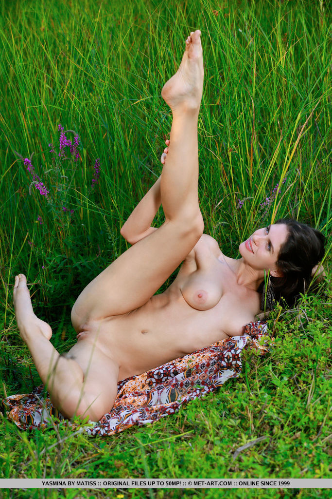 Yasmina flaunts her beautiful tits and sweet ass outdoors.