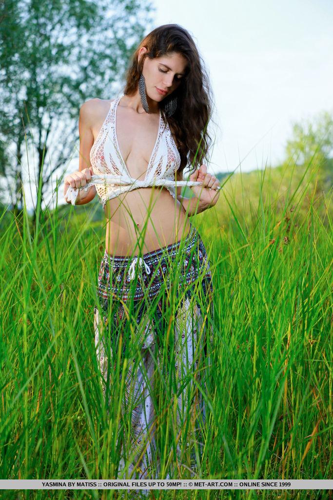 Yasmina flaunts her beautiful tits and sweet ass outdoors.