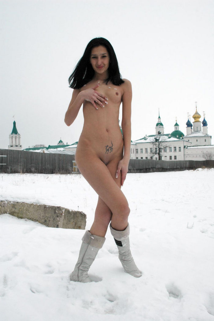 Young brunette remove black panties at snowy field