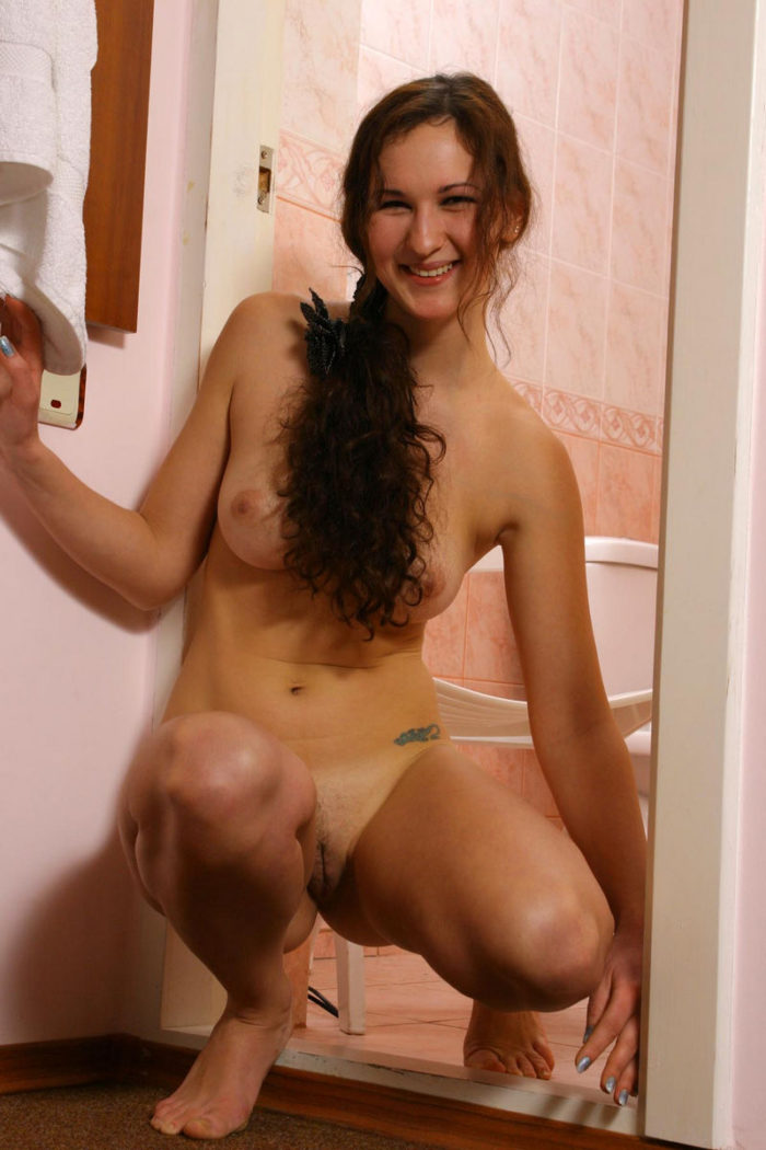 Youthful chesty female in the shower