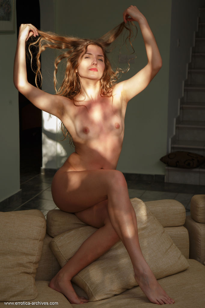 Zoeya displays her unshaven pussy as she poses on the floor.