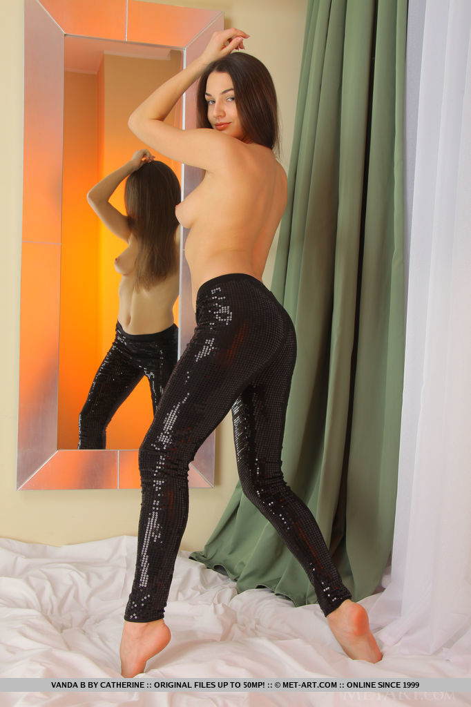 Alluring Vanda B strips her leather tights baring her gorgeous body and delectable assets on the   bed.