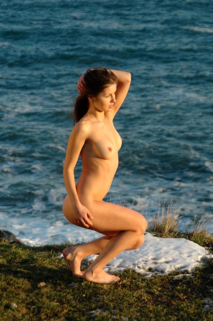 Beautiful russian girl Alexandra B on the shore of the winter sea