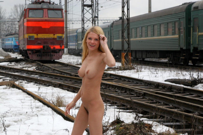 Blonde Uliana A with no clothes posing on railroad