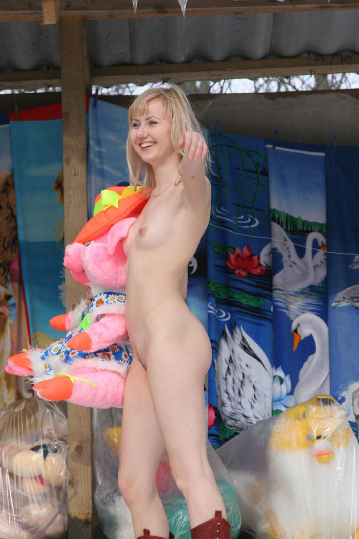 Blonde without clothes posing in the roadside market