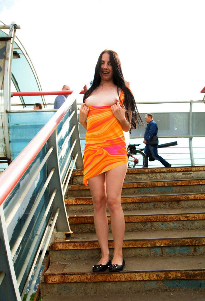 Brunette in bright dress upskirt at public places