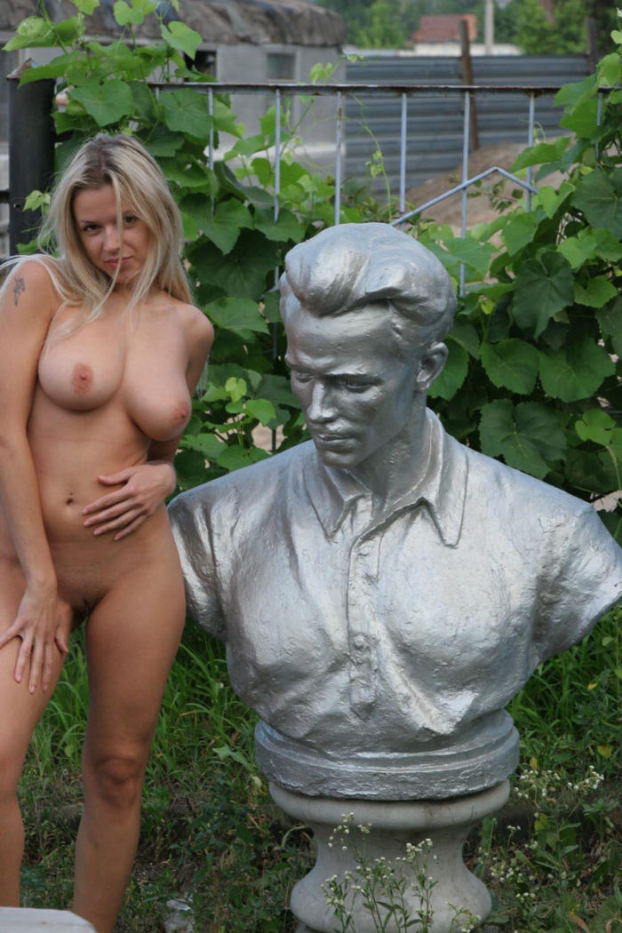 Busty blonde Olga G posing in sculpture store