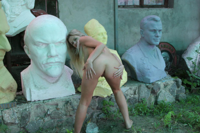Busty blonde Olga G posing in sculpture store