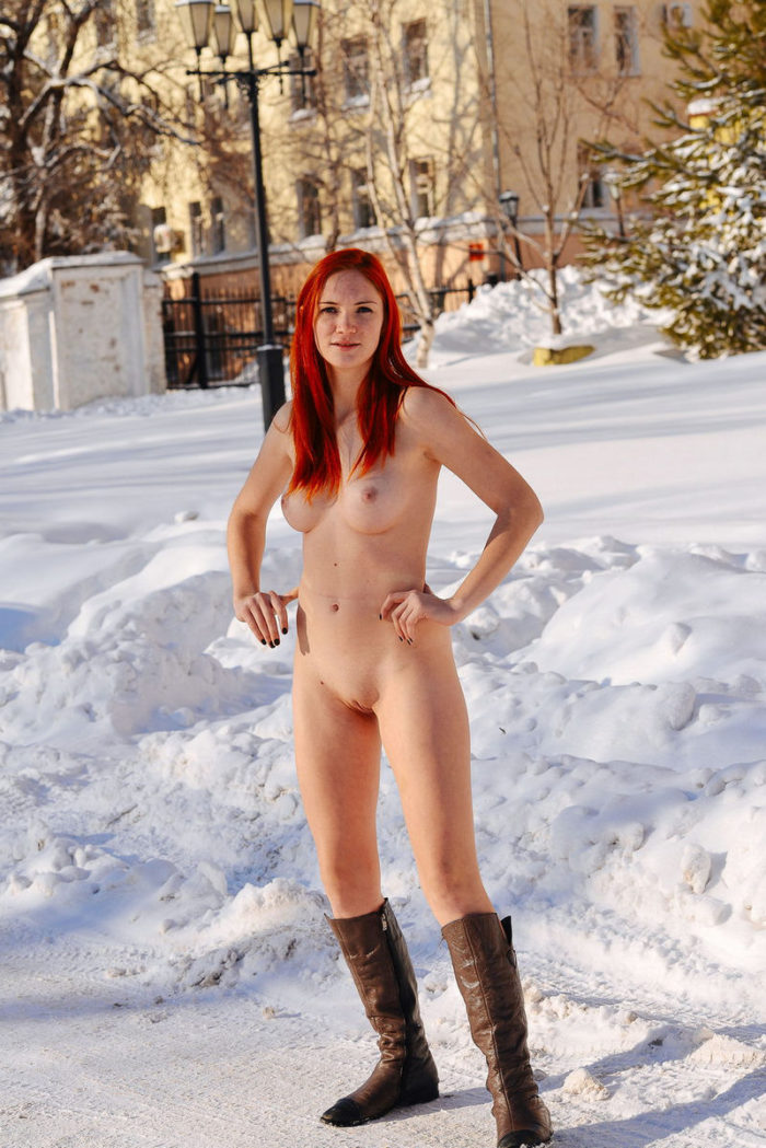 Busty redhead with perfect body at winter streets