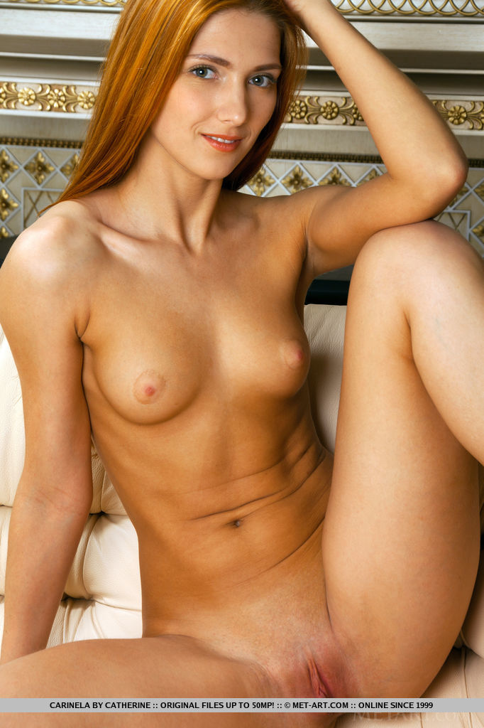 Carinela shows off her sexy naked body as she poses sensually on the couch.