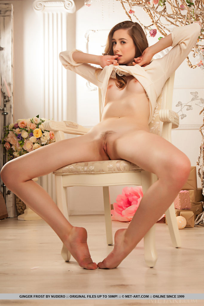Ginger Frost spreads her legs wide open as she displays her unshaven pussy.