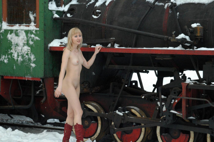 Girl in red boots in the museum of trains