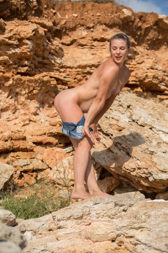 Julia Steel flaunts her sexy, slender body as she poses by the rocks.