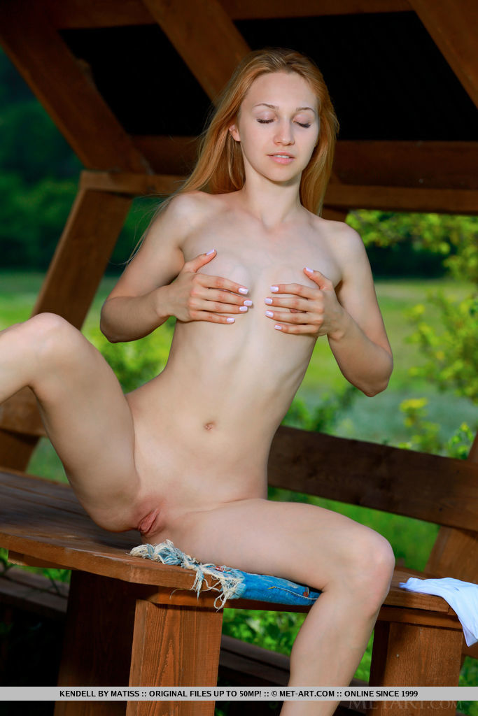 Kendell bares her nubile body and pink pussy in the hut.