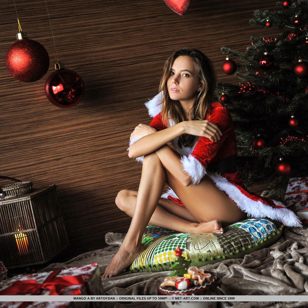 Mango A flaunts her sexy Santa dress as she strips beside the Christmas tree.