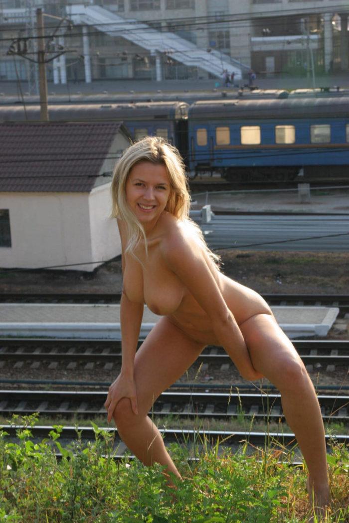 Naked blonde Olga G posing by train station