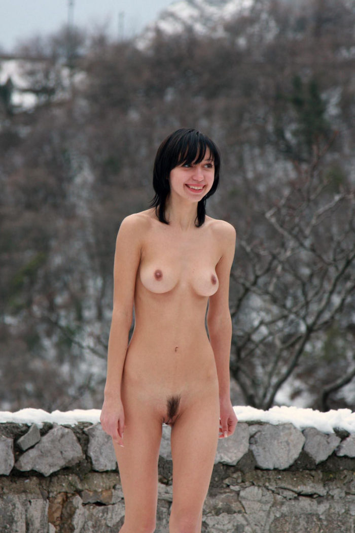 Naked brunette Christina G at winter road
