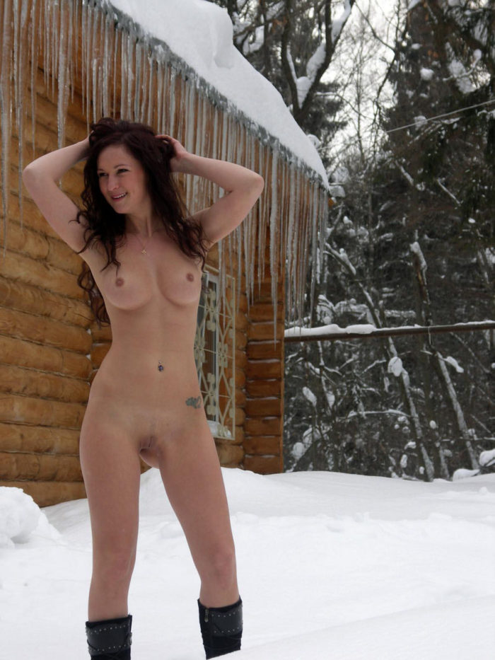 Naked girl Lena S at the snowy cottage