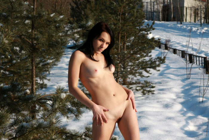 Naked girl Marina M in felt boots in the park