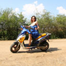 Naked girl Tamara D spreads legs on motorcycle