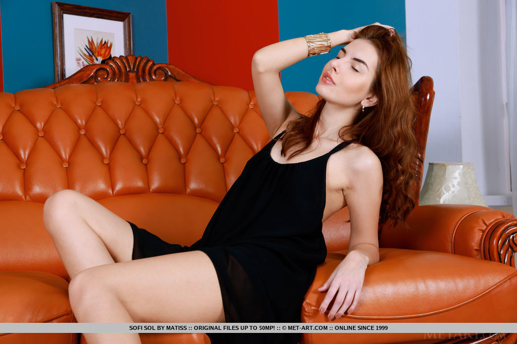 Newcomer Sofi Sol strips on the couch as she flaunts her slender   body.