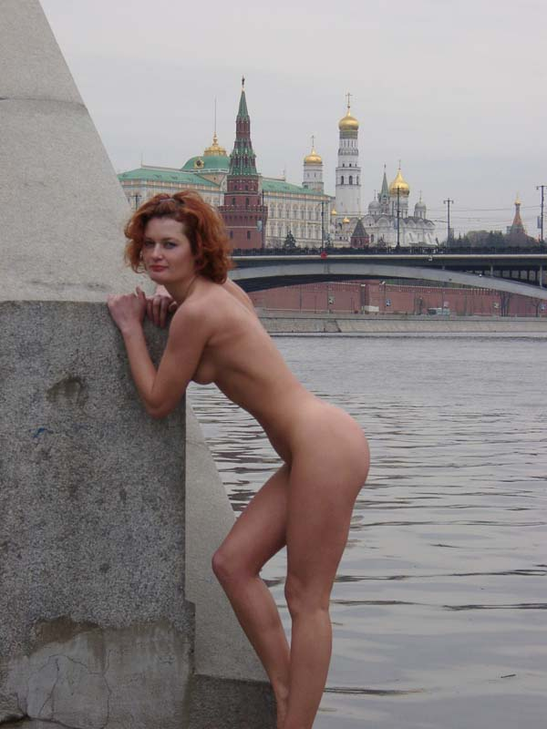Red-haired girl posing in the center of Moscow
