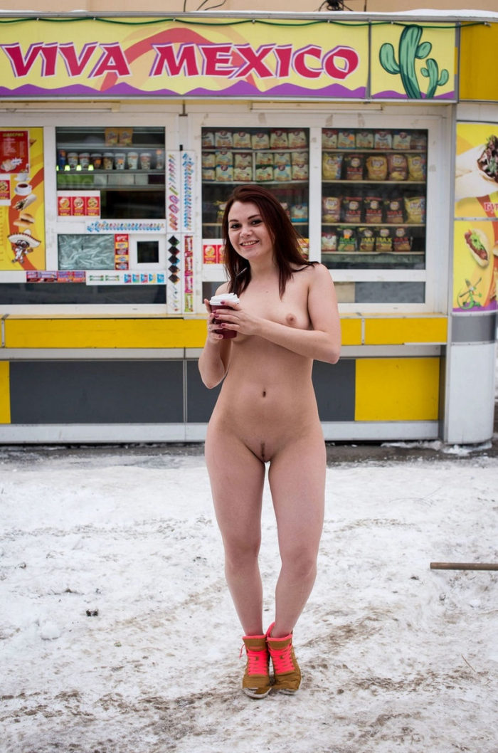 Redhead girl with big ass drinks some coffee at winter streets