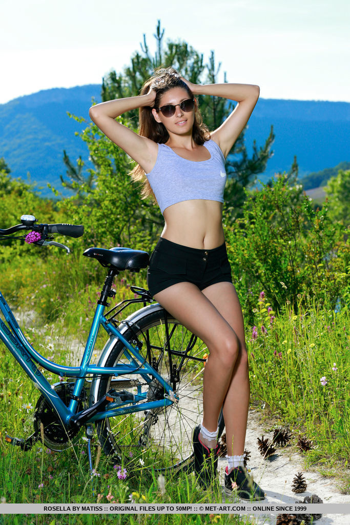 Rosella bares her sexy, tight body on her bike.