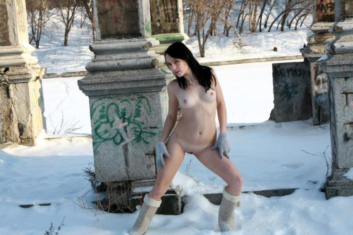 Sexy brunette Marina M near a frozen river