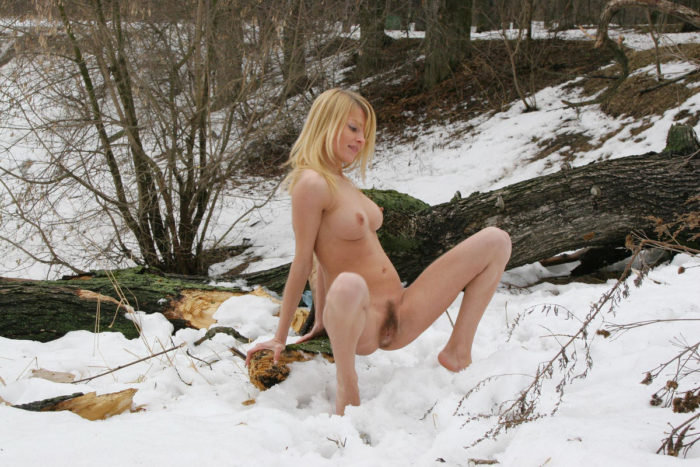 Sexy busty blonde shows her beautiful hairy pussy in park