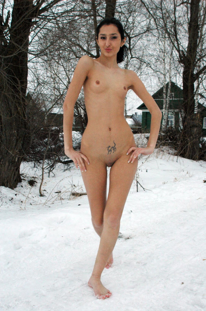 Skinny brunette Toma doggy pose in snow