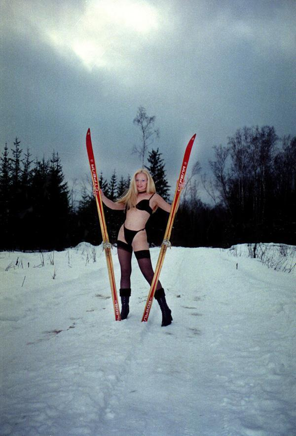 Smiling blonde in stockings on skis!