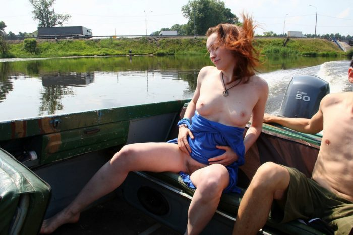 Smiling girl Tamara D shows hairy pussy on small boat