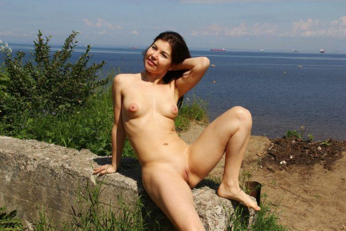 Smiling girl Vika near gulf of Finland