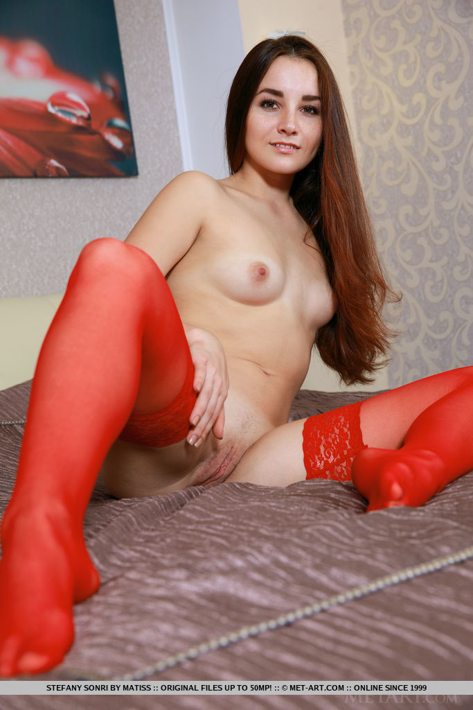 Stefany Sonri strips her sexy, red lingerie as she bares her sexy body.