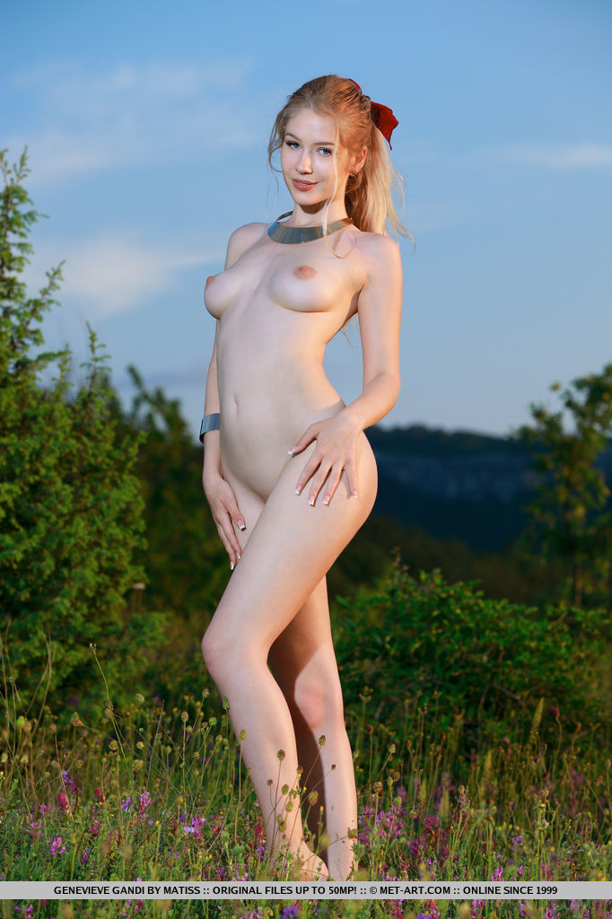 Surrounded by a field of lush greeneries, Genenieve Gandi looks enticingly fresh and youthful with her smooth porcelain skin standing out as she sprawls on the open field.